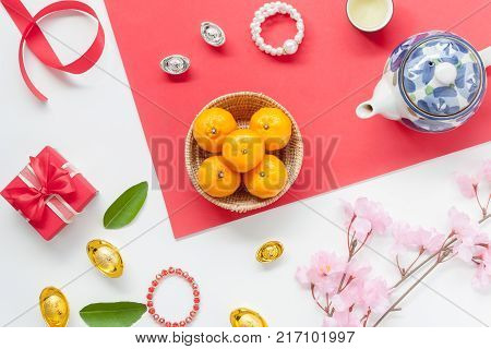 Above view of accessories to travel on Lunar New Year & Chinese New Year vacation concept background.Free space for mock up & template.Difference objects on modern rustic red wooden at home office.
