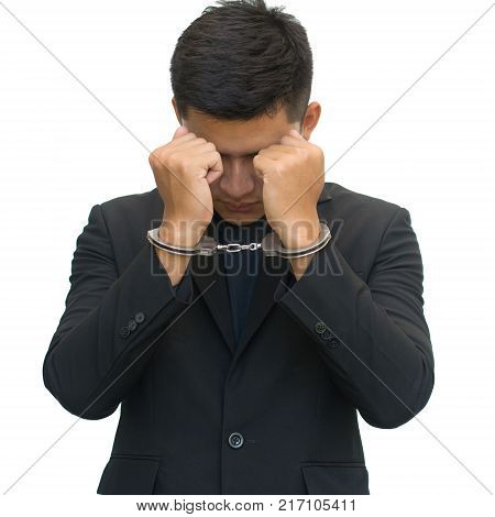 Businessman with handcuffs isolated on white background with clipping path. Corruption concept.