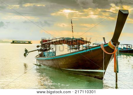 long tailed boat fishing boat motor boat with the sunrays