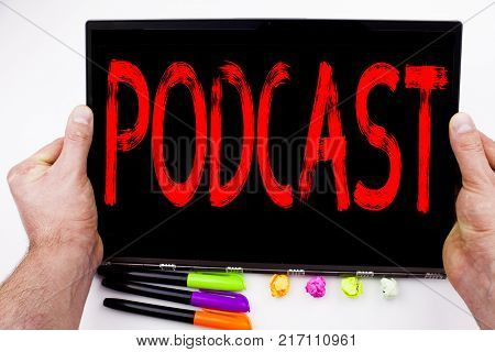 Podcast text written on tablet, computer in the office with marker, pen, stationery. Business concept for Internet Broadcasting Concept white background with space
