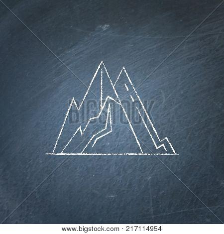 Mountain peaks icon on chalkboard. Outline rock symbol - chalk drawing on blackboard.