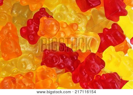 Gummy bear background. Gummy bears as texture. Gum bear candy colorful pattern. Gummy bears.