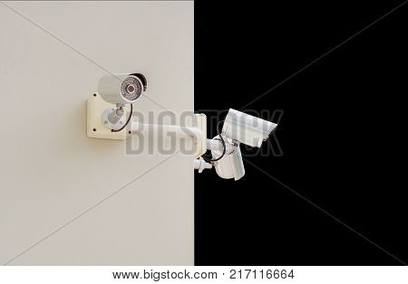 Close Circuit Television on the walls of buildings (CCTV) Security Camera. Day and night security concept. File contains a clipping path.