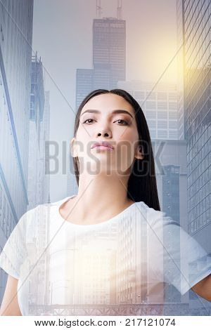 Too arrogant. Serious young stubborn woman looking arrogant while standing with her head up and being quiet after a big quarrel with her emotional husband