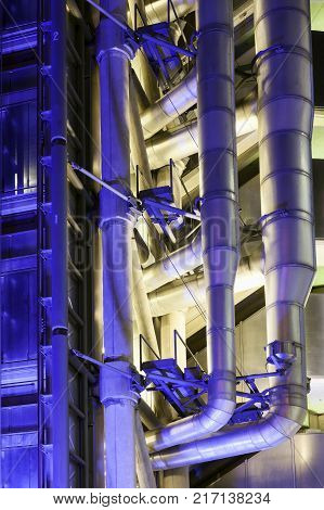 London, UK, January 12, 2012 : Detail of the Lloyd's Building at night which is the headquarters of the insurance firm Lloyd's of London in heart of the city's financial district