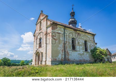 Old desolate and ruined Polish church in Ulashkivtsi village Ukraine