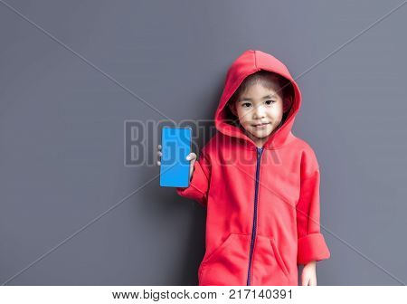 cute asian girl wearing hood in moody face as hiphop singer costume style poster