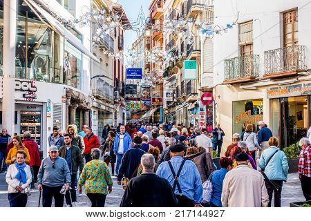 BENIDORM, SPAIN, december 4, 2017: People walking on the shopping street in Benidorm, Alicante, Spain.
