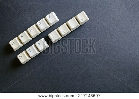 Happy new year 2018 written using white computer keyboard keys with. Holiday technology concept. 2018 new year card