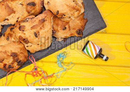 Rock cakes party food in close up with party popper streamer. Simple fun celebration snack. Homemade food.