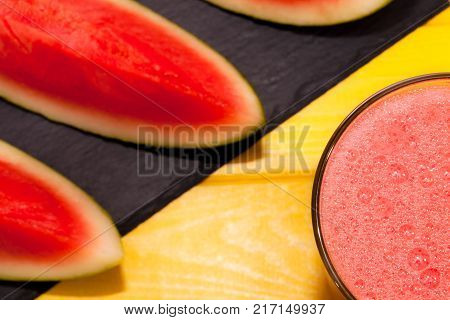 Frothy fruit puree smoothie. Refreshing healthy watermelon summer drink. Colorful vibrant close up image. Cool nutritional food.