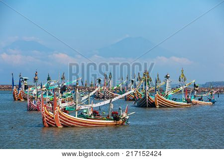 Jembrana Bali Island Indonesia - September 20 2015: Traditional wooden fishing boats mooring in old fishers port on Bali island near Perancak village. Popular place to visit in Jembrana regency.