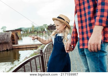 Kid Pointing At Pond