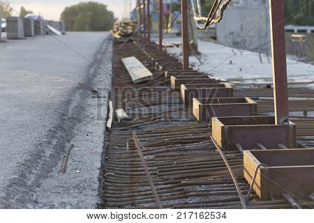 A grid of reinforcement laid on the surface ready for pouring concrete.