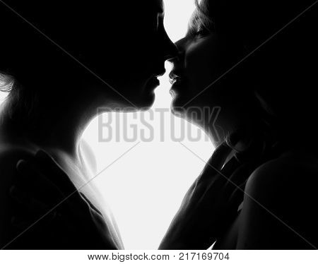 Silhouette Of Two Beautiful Woman Kissing Each Other In Passionate Shot. Duo Toning  Shot. Concept L