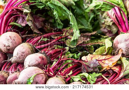 Vegetables display of fresh beetroots with leaves