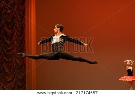 ST. PETERSBURG, RUSSIA - NOVEMBER 16, 2017: Ballet soloist of Kremlin Ballet theatre Mikhail Martynyuk performs during gala concert of Oleg Vinogradov. Great choreographer celebrated 80th anniversary