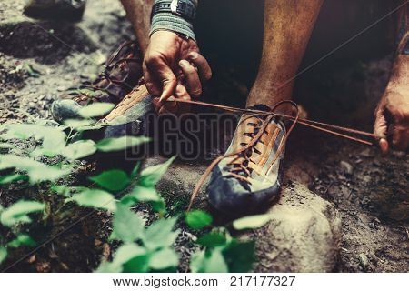Man Dresses Climbing Shoes For Climbing close-up. Extreme Hobby Outdoor Activity Concept