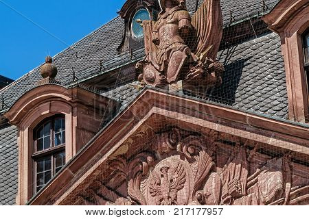 FRANKFURT, GERMANY-JULY 21, 2017: The historic Café Hauptwache baroque relief (located in the middle of the city of Frankfurt). Popular meeting place since its opening over 100 years ago.
