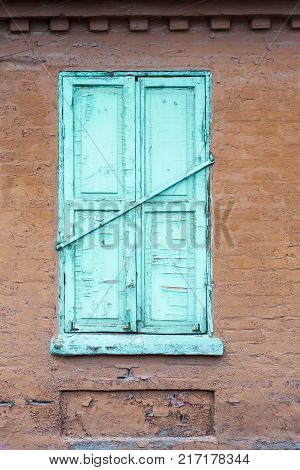 Old vintage retro wooden turquoise cracked paint window blinds, as historic architecture background