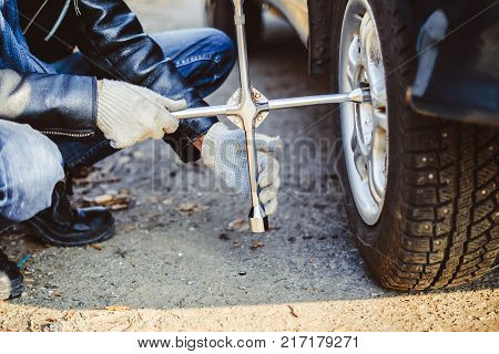 Change a flat car tire on road with Tire maintenance, damaged car tyre