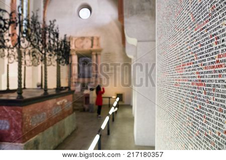 PRAGUE CZECH REPUBLIC - JULY 2: The walls of Pinkas synagogue covered with the handwritten names of all the Czech Jews that died at the hands of the Nazis on July 2 2017 in Prague