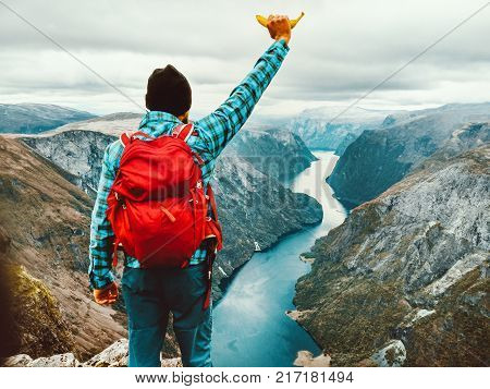 Go Vegan concept Traveler Man with banana Healthy Lifestyle Travel adventure vacations above Naeroyfjord in Norway
