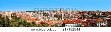 Burgos, Spain. Panoramic view of Burgos - historic capital of Castile in Spain. Popular historical landmarks - Cathedral and various churches and old architecture. Fields at the background. Blue sky