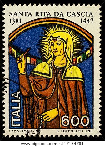 Moscow Russia - December 07 2017: A stamp printed in Italy shows portrait of Saint Rita of Cascia (1381-1457) dedicated to the 600th Anniversary of the Birth of St. Rita of Cascia circa 1981