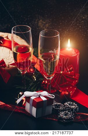 Christmas Or New Year. Champagne In Glasses With Candles, Panettone And Gift With Red Satin Bow. Cop