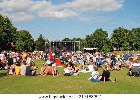 TENTERDEN, ENGLAND - JULY 2, 2017: People enjoying the annual Tentertainment music festival at Tenterden in Kent. The free festival was first held in 2008.