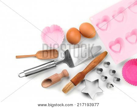 Set of kitchenware for cooking pastries on white background