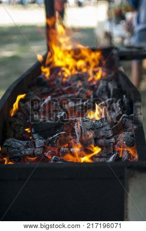 BBQ with wood burning bright. selective focus.