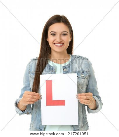 Young woman holding learner driver sign on white background