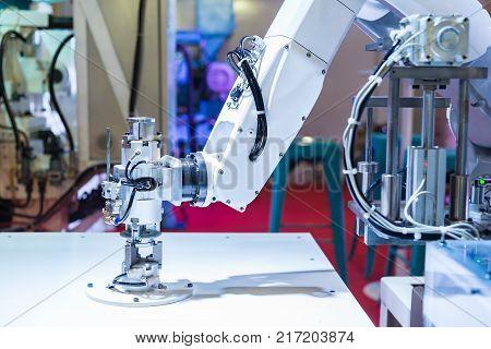 Industrial robot is test run welding new program in car factory