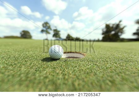 Close-up of golf ball on grass.Golf ball on tee with blue sky background
