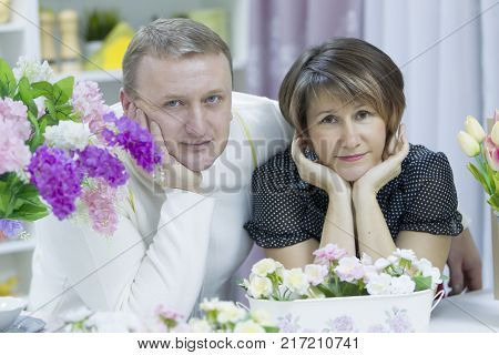 Husband and wife. Happy elderly couple. Love of middle age. A middle-aged man and a middle-aged woman.
