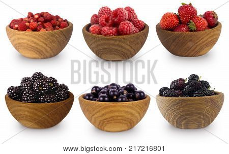 Black and red berries isolated on white background. Mulberry black berry blackcurrant red currant and strawberry. Collage of different fruits and berries. Sweet and juicy berry with copy space for text.