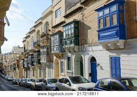 The Traditional Maltese Colorful Wooden Balconies In Sliema On Malta