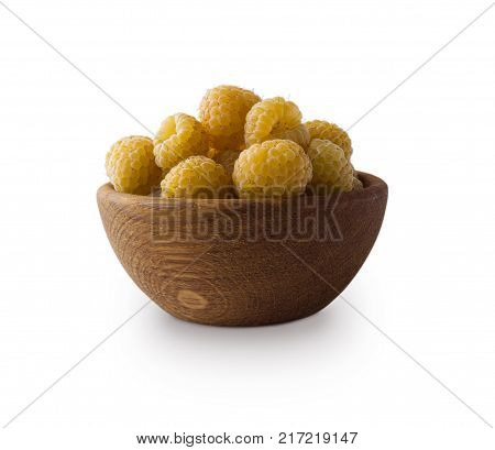 Raspberries in a wooden bowl. Yellow raspberries isolated on white. Vegetarian or healthy eating. Juicy and delicious yellow raspberry with copy space for text. Berry on a white background