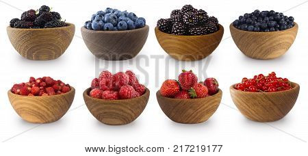 Sweet and juicy berry with copy space for text. Blue-black and red berries isolated on white. Mulberry blueberry blackberries red currant strawberry and raspberry. Collage of different fruits and berries. Berry on a white background