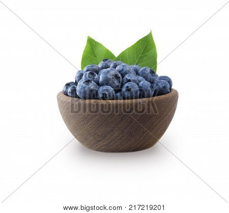 Blueberries in a wooden bowl isolated on white. Ripe blueberry with copy space for text. Bilberry on a white background