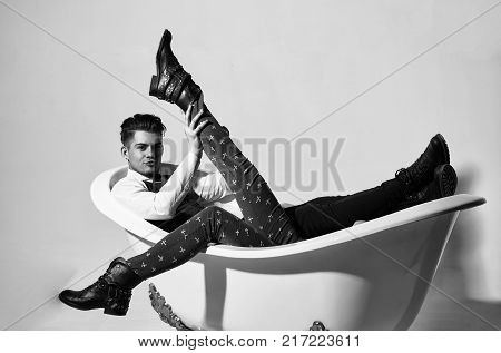 Handsome Man Or Businessman Relaxing With Female Legs In Bath