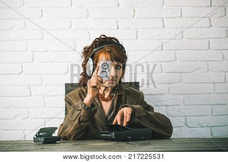Old woman with cassette recorder listen music in headphones. Old school music player radio. Granny dj in headset with cassette player. Spy and operator. Audio book and new technology education.