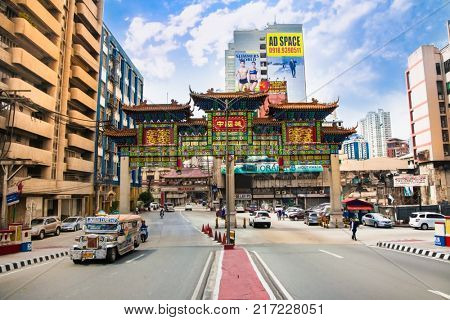 MANILA, PHILIPPINES- APR 1, 2016. Traffic on street at Chinatown in Manila on Apr 1, 2016, Philippines. Manila Chinatown is one of the largest and oldest in the world.
