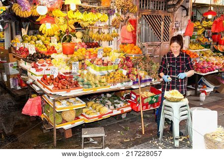HONG KONG - JULY 14 2017: A fruit and vegetable stall in Sai Kung a popular seaside fishing village in Hong Kong. Sai Kung village is famous for its seafood restaurants and floating fish market.