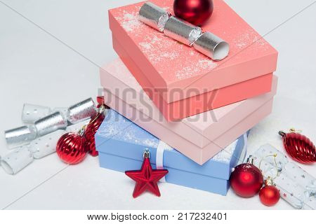 Christmas Presents In Gift Wrap On White Background In Gift Wrap On A White Background