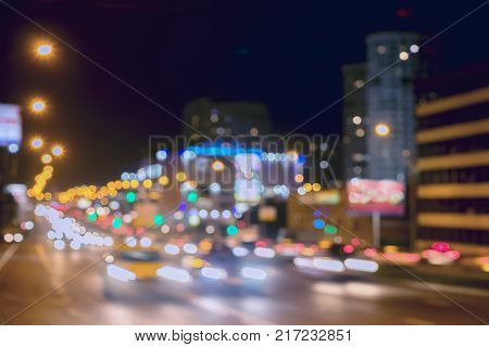 Urban street night traffic with bokeh lights. Blurred auto with brake lights, city street lights and speed. Abstract bright blurred background