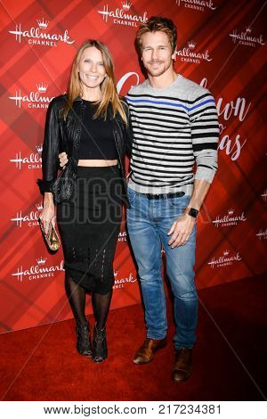 LOS ANGELES - DEC 4:  Charity Walden Joiner, Rusty Joiner at the Christmas At Holly Lodge Screening at 189 The Grove Drive on December 4, 2017 in Los Angeles, CA