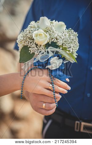 Wedding close picture of bride bouquet of flowers roses hold by couple husband and wife Romantic scene of young family love between man and woman.